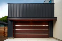 Contemporary Mahogany garage with dark oak stain and stainless steel inlays.