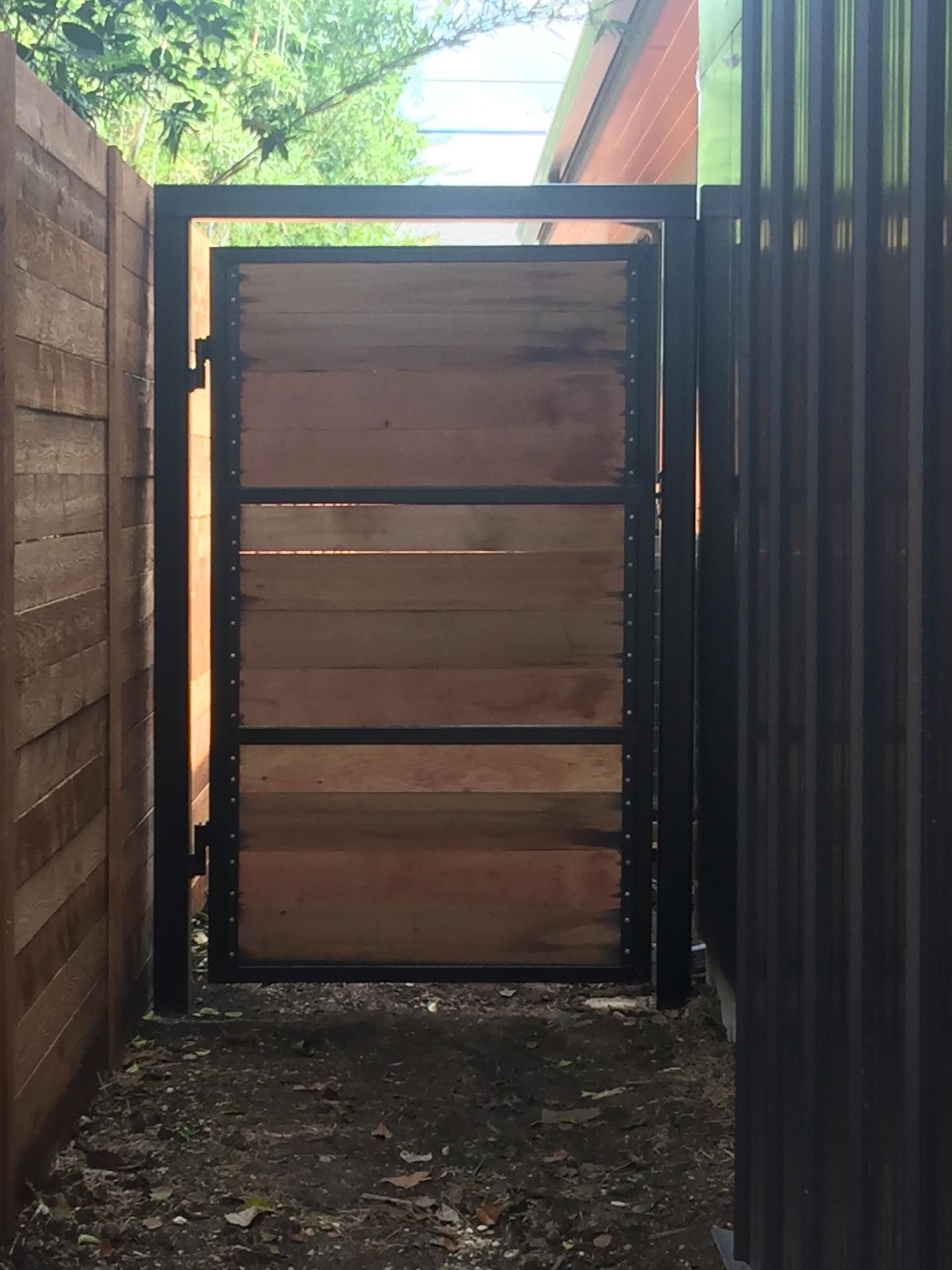 Vertical grain Douglas Fir wood gate door with black steel.