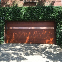 Hemlock wood garage door in Teak stain with a Copper inlay.