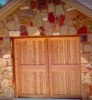 Cedar barn style garage doors with clear coat finish.