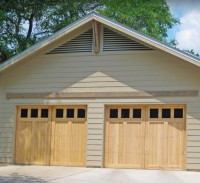 Traditional Cedar garage doors with square-paned windows.