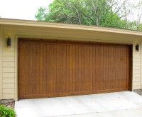 Contemporary Cedar garage doors with a customized stain.