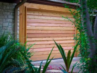Contemporary Cedar door with horizontal overlays in an ornate frame with a clear coat stain.