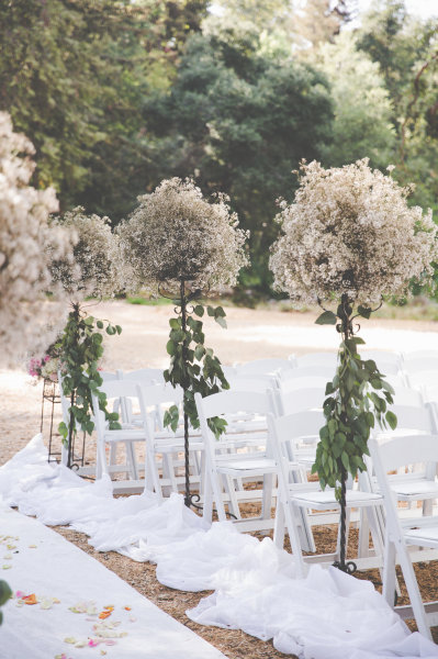 Romantic Aisle with lots of baby breath!