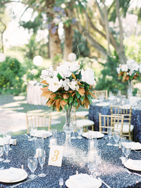 White and gold with blue sequins linens