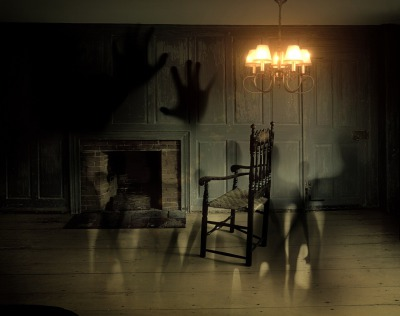 Haunted fireplace with rocking chair and ghost