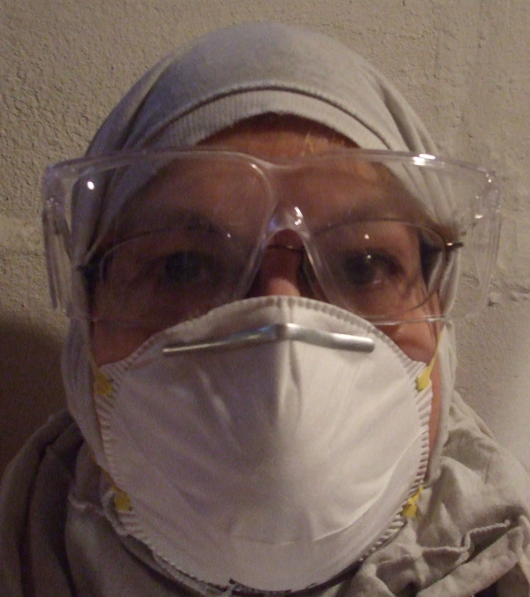 Woman with safety googles and dust mask