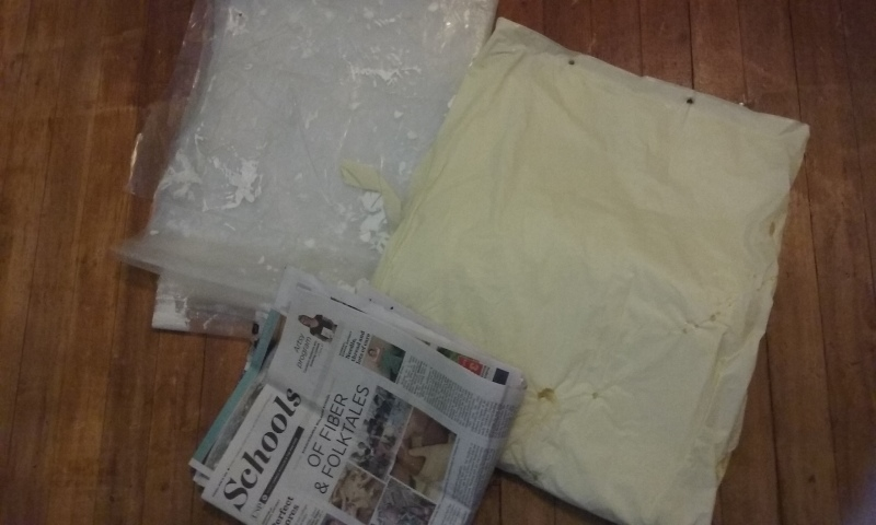 Old newspaper to catch paint, old plastic shower curtain liner to catch paint, plastic drop cloth