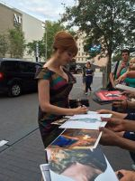 Christina Hendricks signing autographs