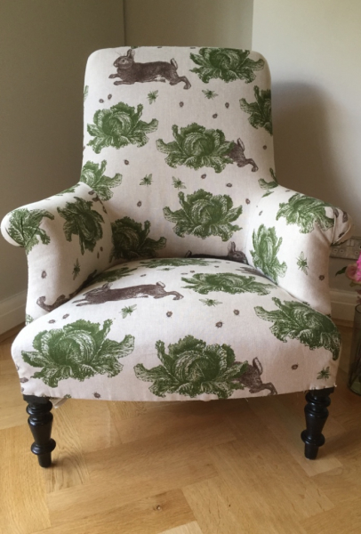 Traditional French armchair in Thornback and Peel's Rabbit and Cabbages linen