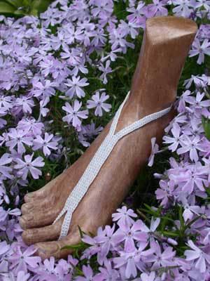 wooden foot display nude shoe