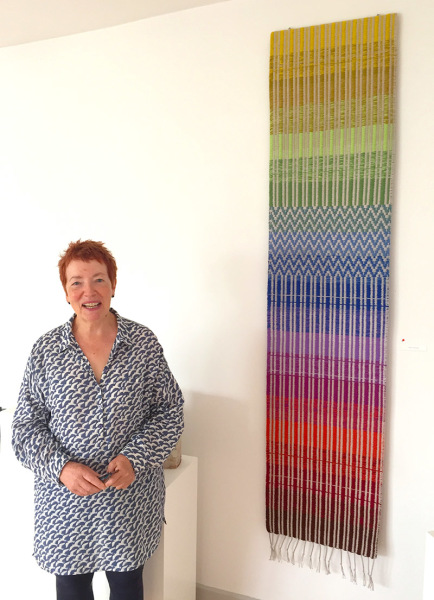 Mary Gallagher of Blue Egg with Tapestry by Terry Dunne