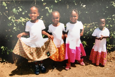 The little children at Imara International receive my dresses!