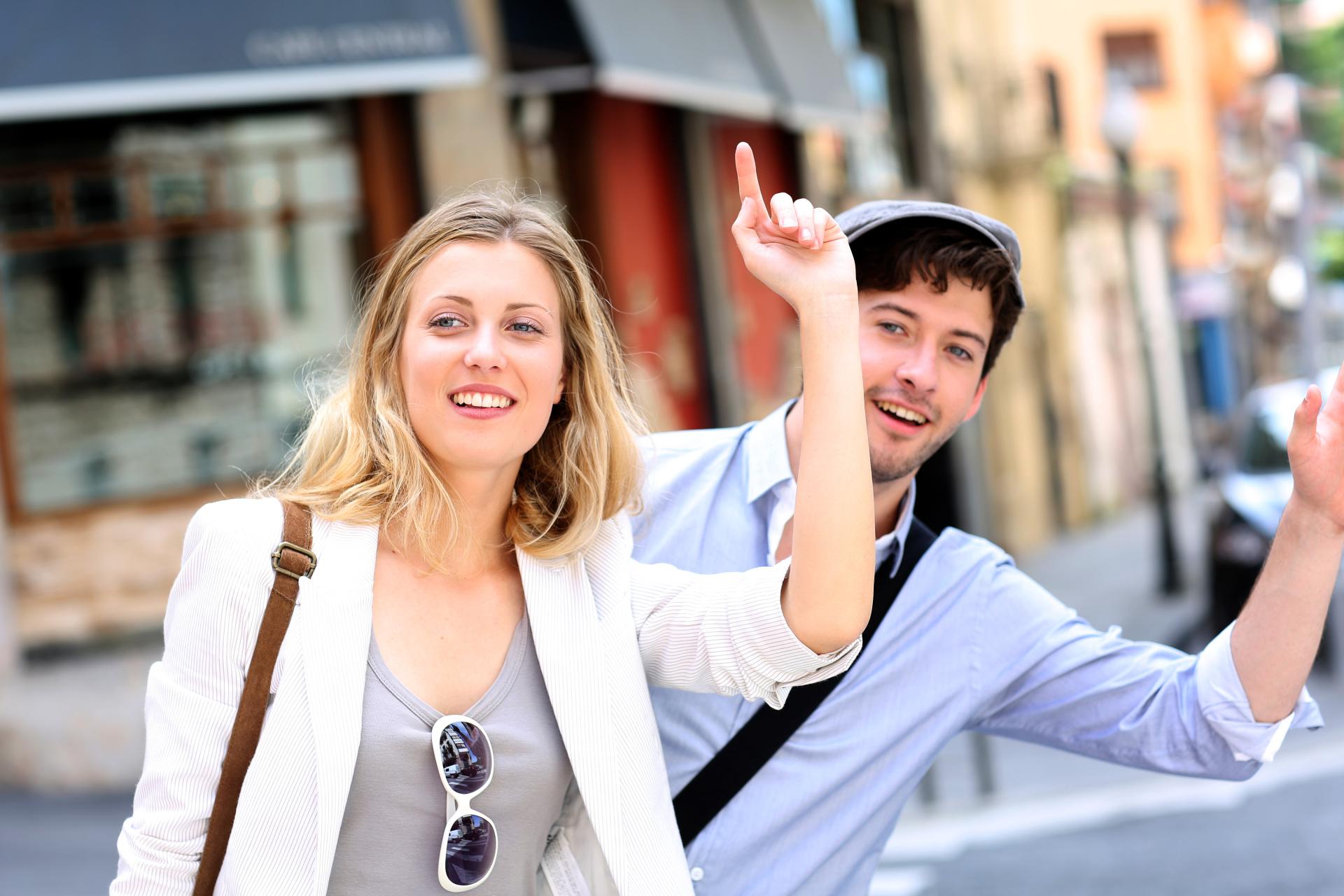 couple hailing a taxi, taxi service