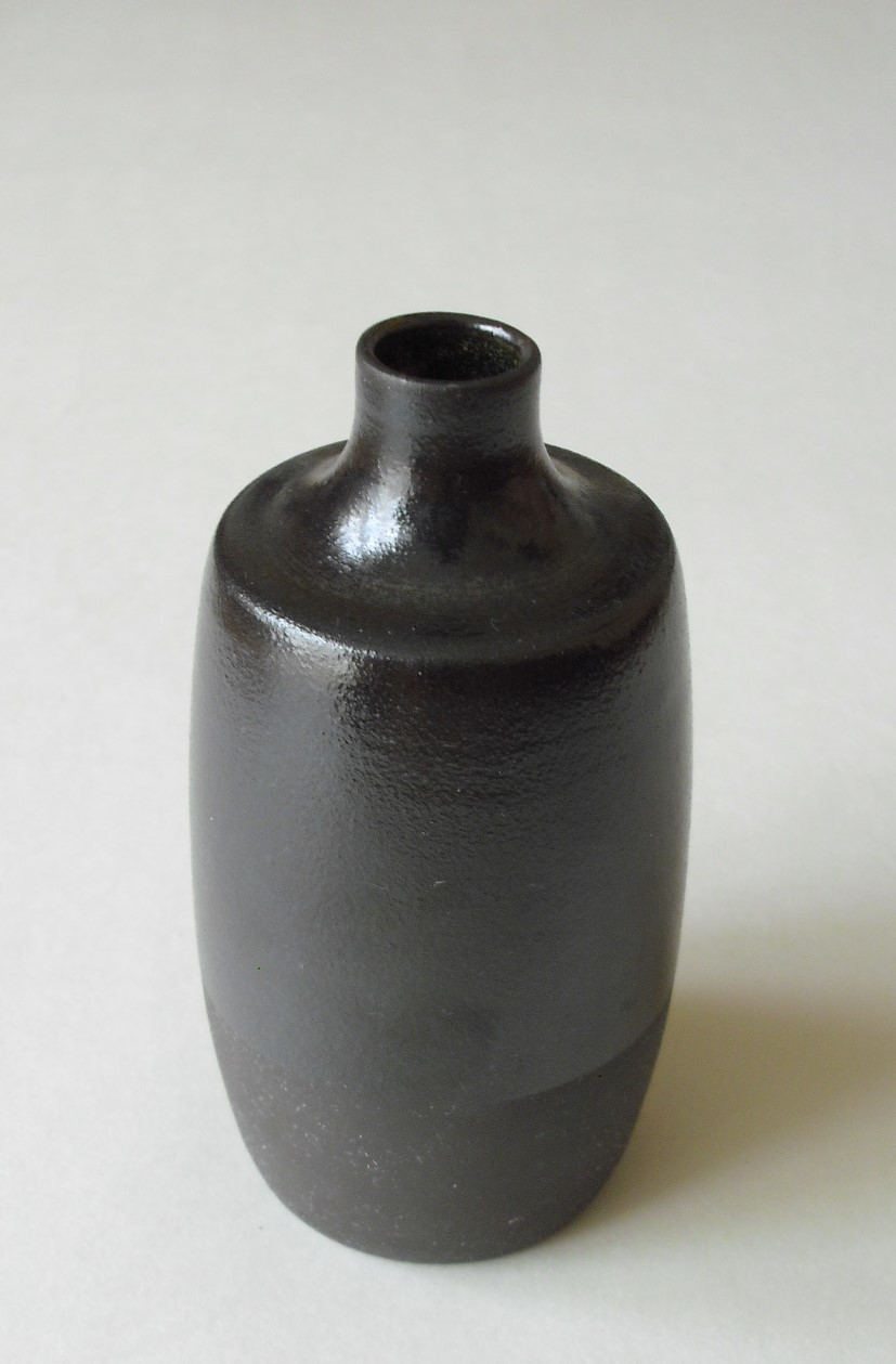 Handmade black and brown bottle