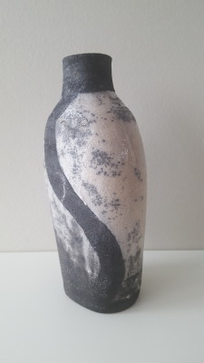 Wheelthrown blossom and black raku fired bottle/vase