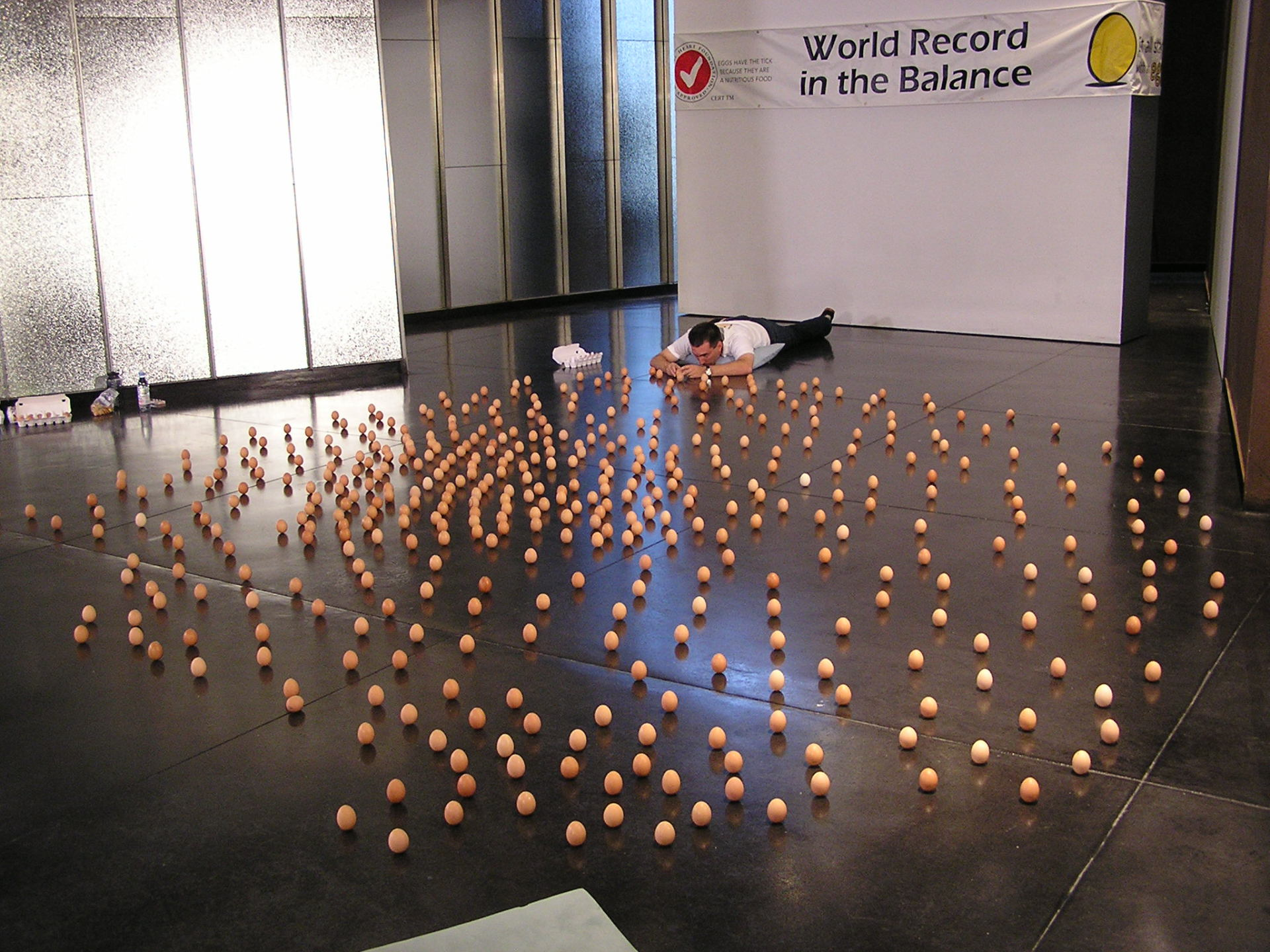 Balancing eggs on the floor of the Australian Centre for Contemporary Arts