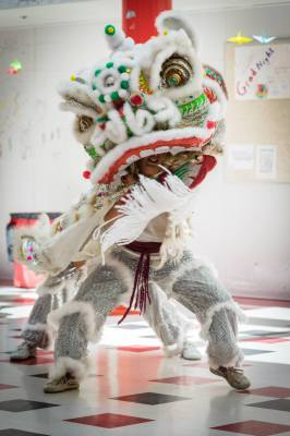 Lion Dance image, Ms. Secord and Mr. Vash dance a Coconino High School