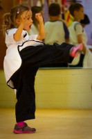 perfect practice makes perfect.  Ms. Rasmussen working her side kicks!