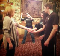 Sifu Banks coaching Women's Self Defense participants through grab defenses.