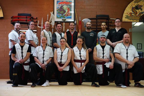 Black Belt Class Image. First generation black belt graduates with Instructors Burns and Guzman and Master Kaneen