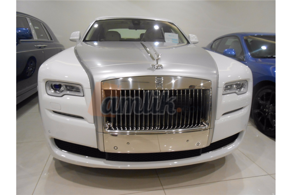 white and silver Rolls Royce ghost 2016