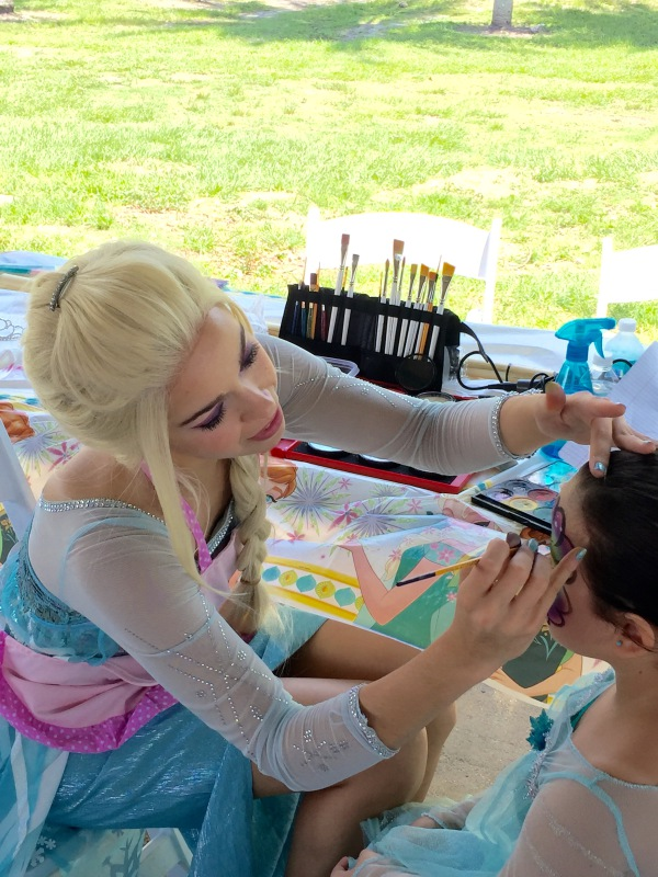 Elsa face painting a lucky little girl