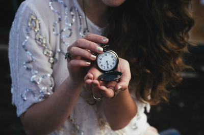 Woman holding pocket watch