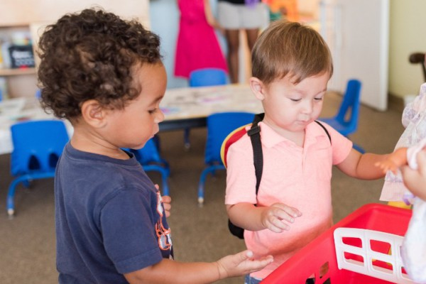 two preschoolers playing in spanish immersion classroom