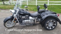 Black Suzuki Boulevard motorcycle converted to trike with conversion kit.