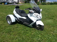 White Burgman motorcycle converted to trike with conversion kit.