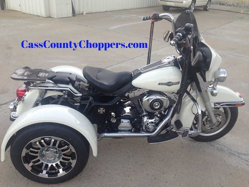 White Harley Roadking motorcycle converted to trike with conversion kit.