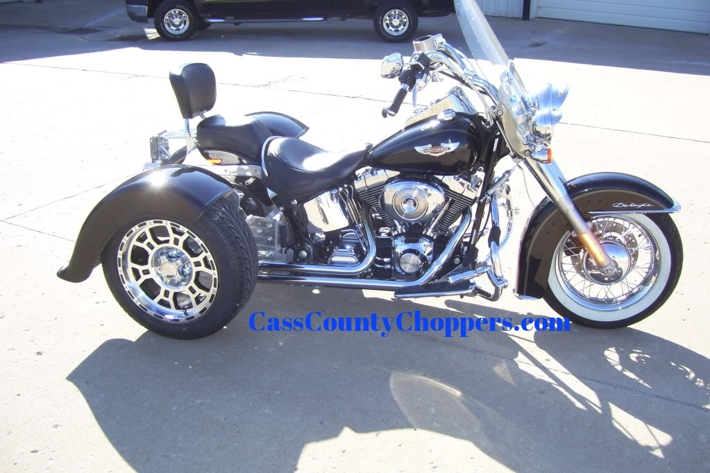 Black Harley Softail motorcycle converted to trike with conversion kit.