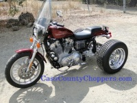 Orange Harley Sportster motorcycle converted to trike with conversion kit.