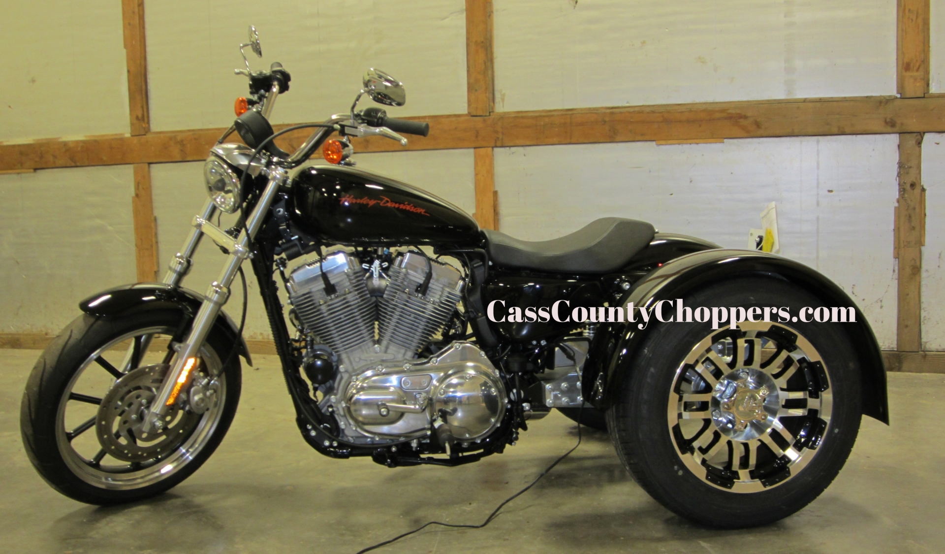 Black Harley Sportster motorcycle converted to trike with conversion kit.