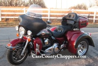 Red Harley Ultraclassic motorcycle converted to trike with conversion kit.
