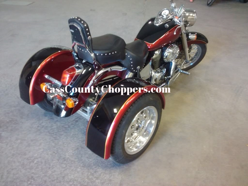 Orange Honda Shadow motorcycle converted to trike with conversion kit.
