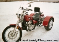 Red Kawasaki Vulcan 500 motorcycle converted to trike with conversion kit.
