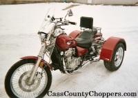 Red Kawasaki Vulcan 500 motorcycle converted to trike with conversion kit.
