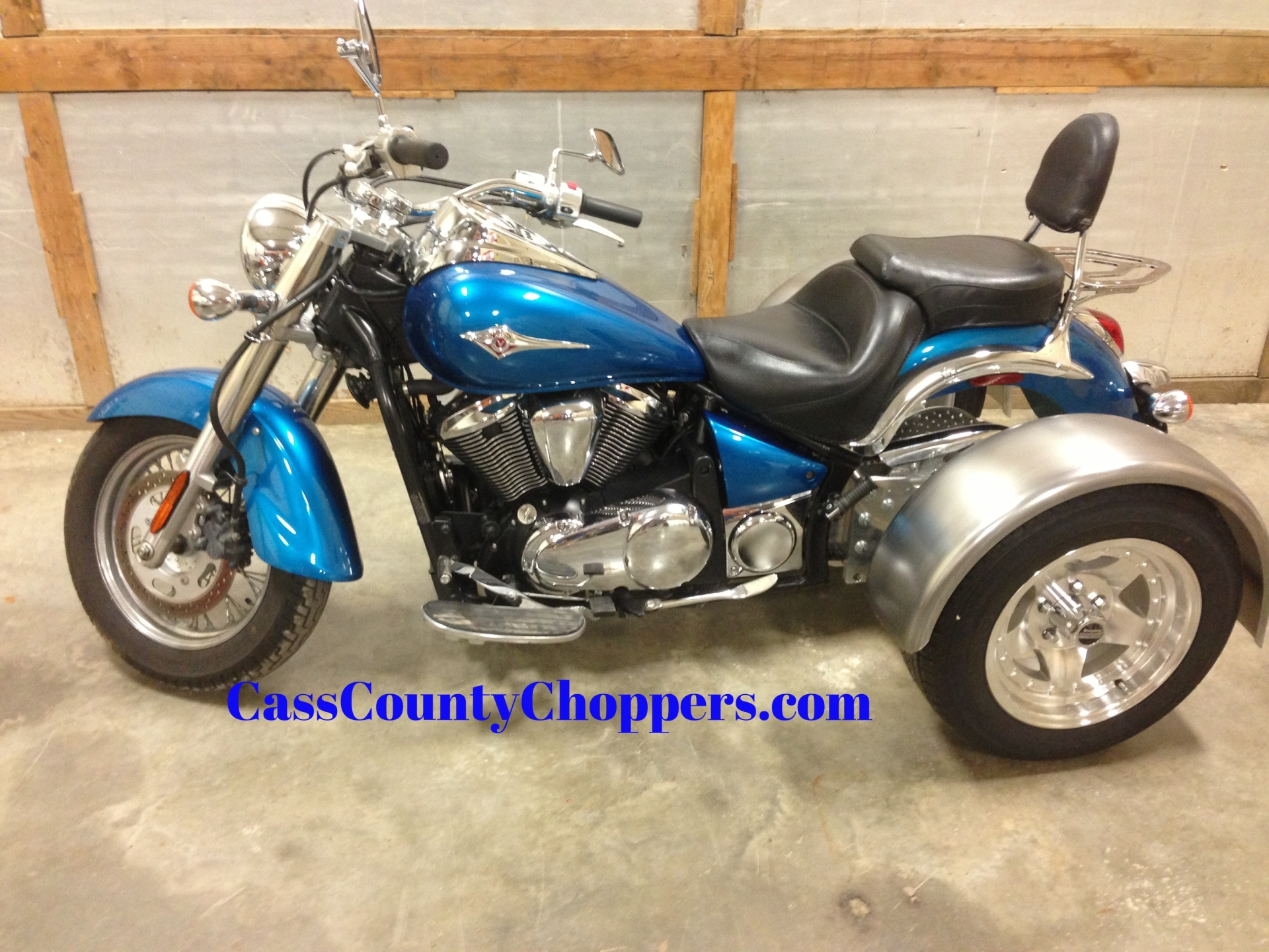 Light blue Kawasaki Vulcan 900 motorcycle converted to trike with conversion kit.