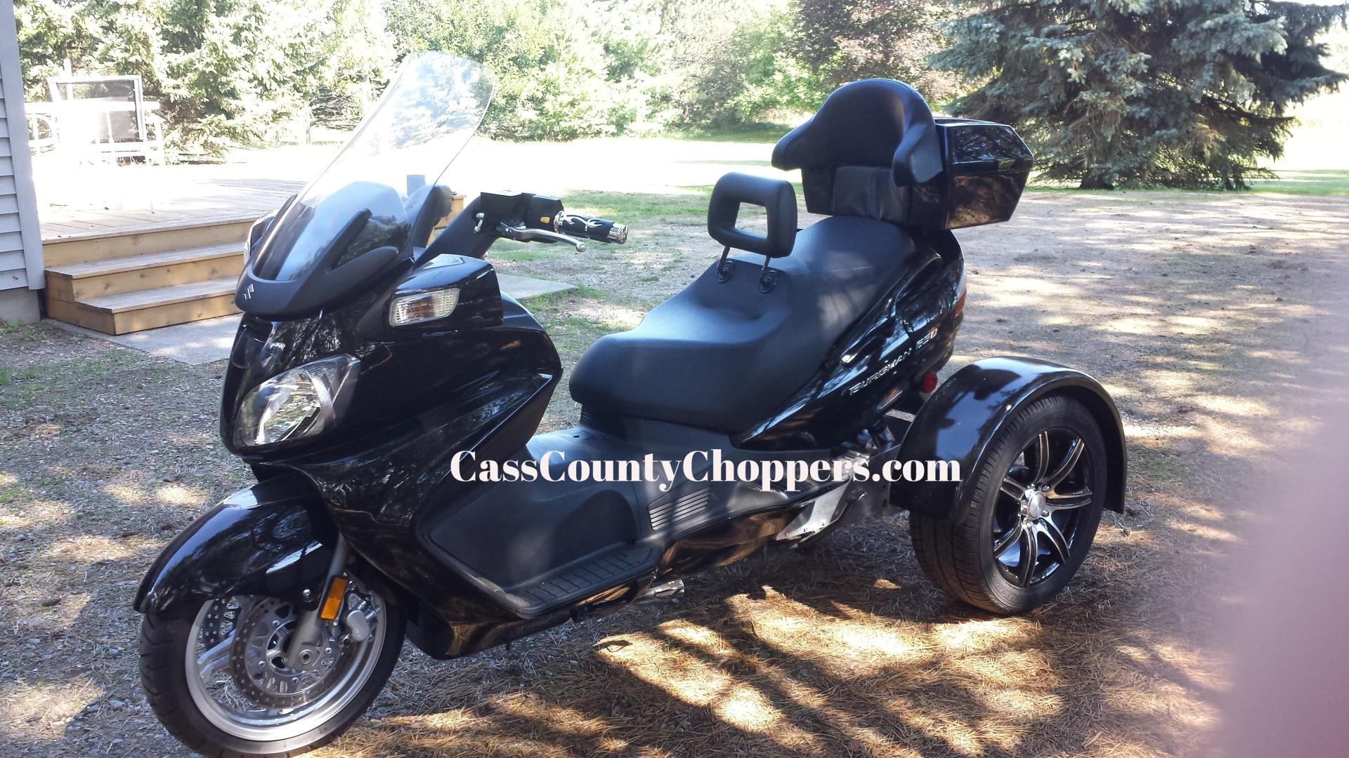 Black Suzuki Burgman motorcycle converted to trike with conversion kit.
