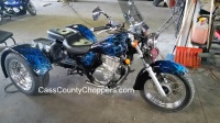 Blue Suzuki GZ250 motorcycle converted to trike with conversion kit.