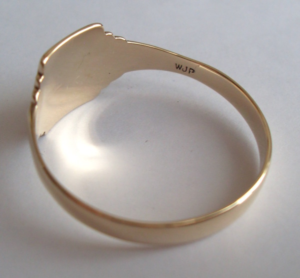 Rosalyn's Emporium 9ct Gold signet wedding ring after repair. The initials engraved inside the original wedding ring were saved so no detail was lost during the repair job.