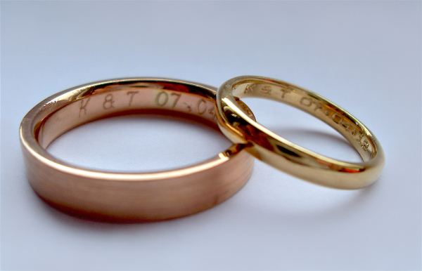 Rosalyn's Emporium 18ct Rose & Gold wedding rings. This couple wanted different colour gold but chose to have their initials & wedding date engraved inside each ring to connect them together.