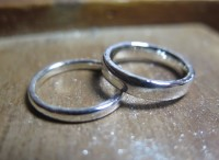 A pair of platinum wedding rings handmade by the couple themselves during an experience day at Rosalyn's Emporium