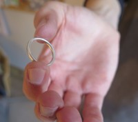 Groom holding the platinum wedding ring he has made for himself during an experience day at Rosalyn's Emporium