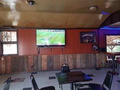 """70"""" TV plus 4 other TV's for all your sports coverage"""