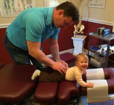 Dr McAlister adjusting toddler