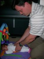Dr McAlister adjusting a newborn