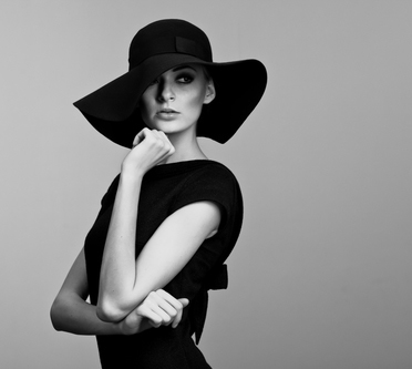 Black and White Photo of a Woman in a Big Hat